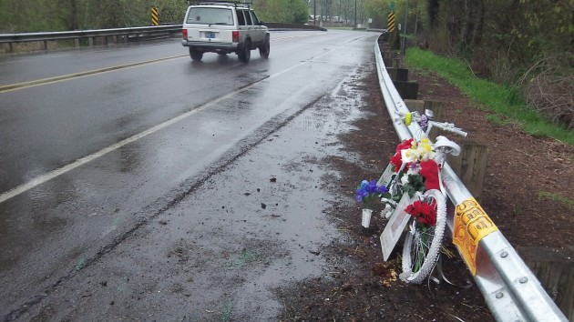 Traffic passes the roadside memorial for Grant Keith Garner on a rainy day last week.