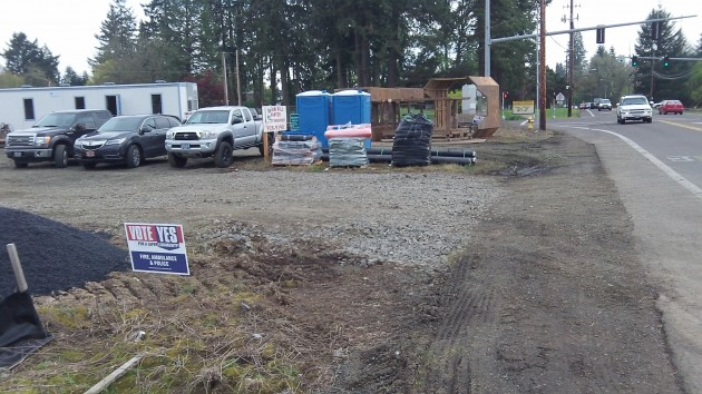A construction yard is set up alongside North Albany Road.