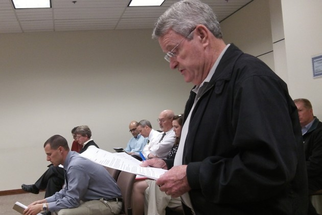 Tom Cordier reads his proposal to the Albany City Council Monday.