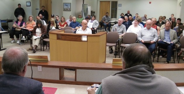 Developer Myles Breadner, in the box, talks to the council Wednesday.