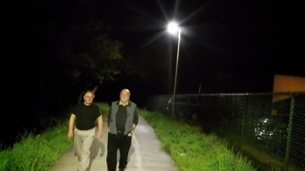 Councilors Rich Kellum and Floyd Collins check out the lighting during Thursday night's demonstration.