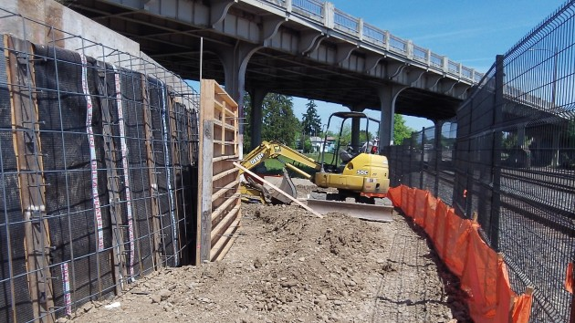Forms for retaining walls are being built along the new path under the Pacific Boulevard viaduct.