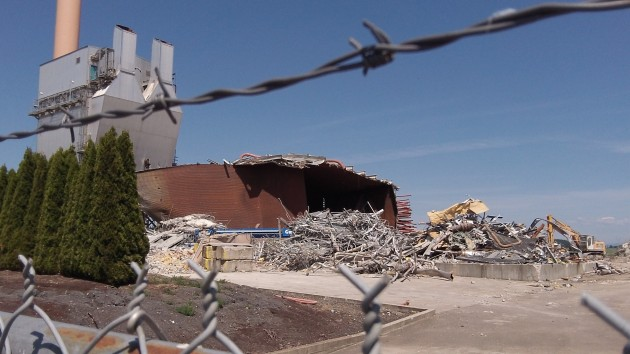 Piles of metal and the remaining structures.