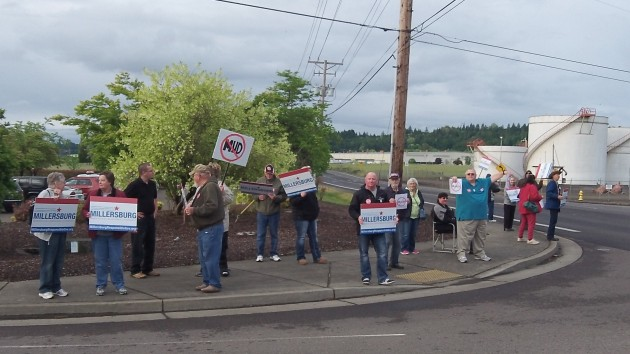 Citizens opposed to the power takeover demonstrate outside Millersburg City Hall Tuesday evening.