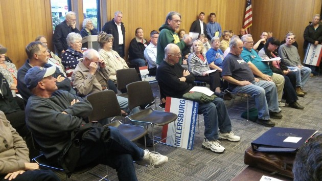 The audience waits for the Millersburg council's decision Tuesday.