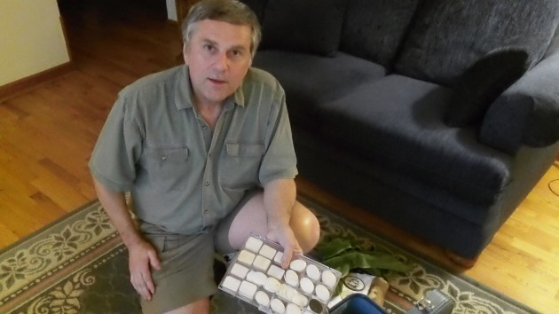 Kenn Holmes with some of his many pieces of ivory he plans to turn into works of scrimshaw art.
