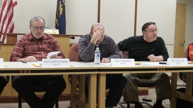 Rich Kellum (at right in this file photo) forced a delay in Albany's planned fee increase on electric service.