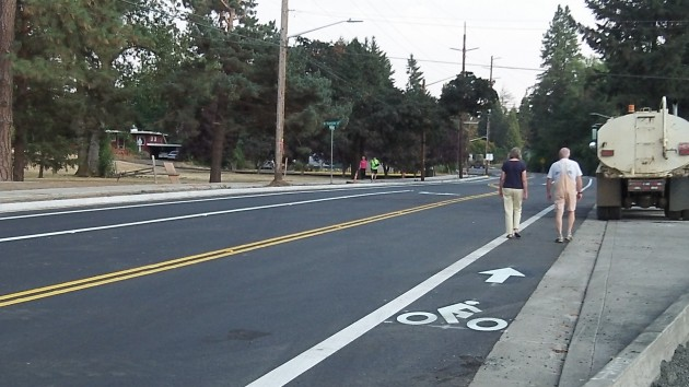 Walkers sample the new pavement on North Albany Road Monday evening.