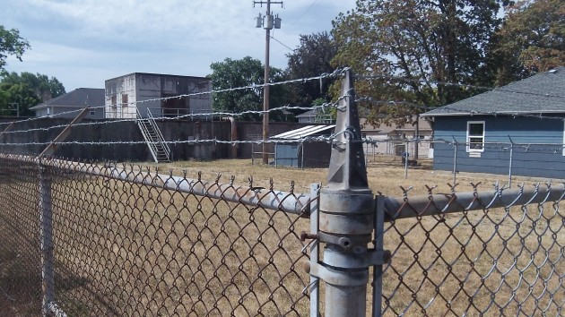 This address on Southeast Burkhart Street is protected by a sturdy wire fence.