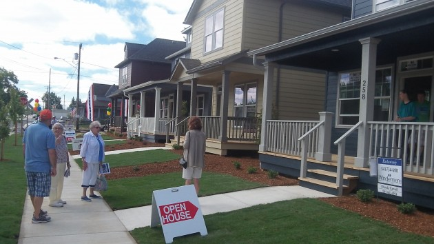 Visitors check out the first finished houses at Edgewater Village Saturday.