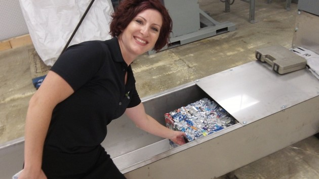 Cherilyn Bertges points out how cans are compressed into cubes if several hundred each.