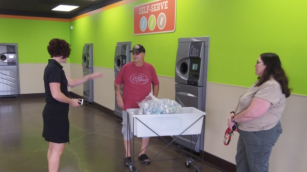 Bertges talks to two of the first customers who came to return empties.