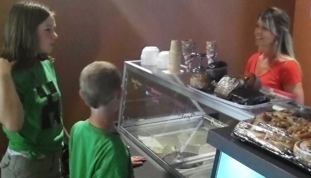 Friendly service: Behind the ice cream freezer, owner Linda Hogan.