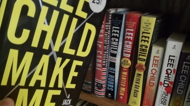 The latest title in the Reacher series and some of the others on my shelf.