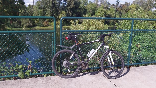 Parked by the river on the Dave Clark bikeway and walking path.