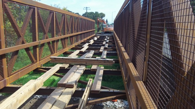 The Owl Creek bridge still needs a deck to ride and walk on.