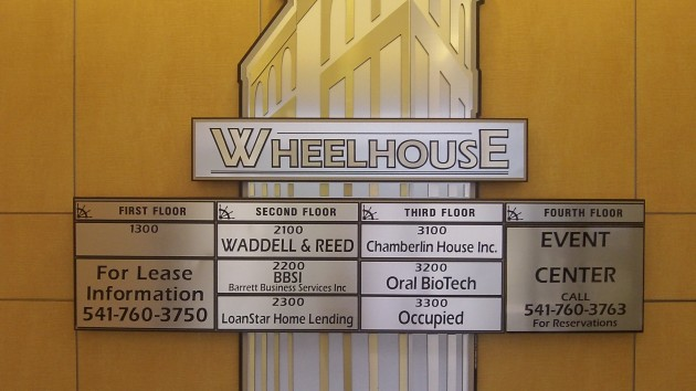 The office directory on the back wall of the Wheelhouse lobby.