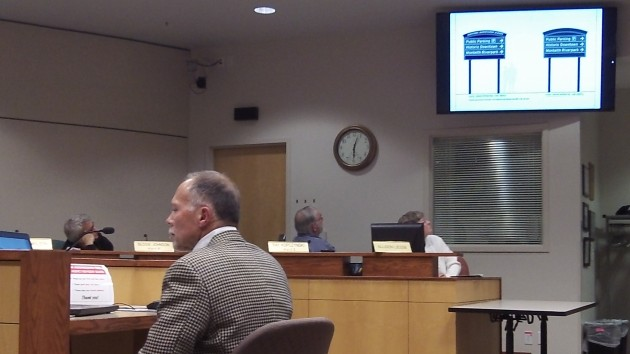 Designer Ken Ambrosini shows the CARA board what downtown signs would look like.