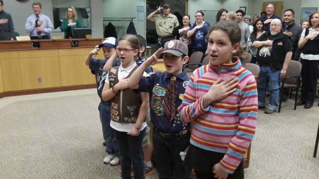 Children lead the Albany council and audience in the Pledge on Wednesday night.