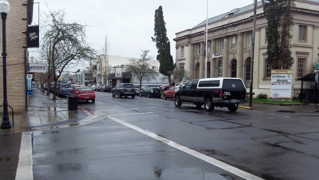 This and other intersections would get curb extensions. On the right, the old post office.
