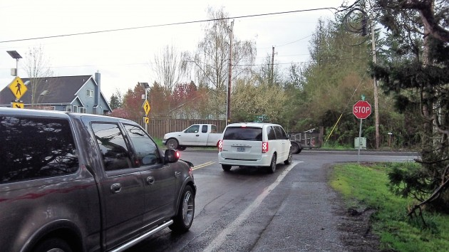 Vehicles wait on Crocker Lane before turning on Gibson Hill Road in North Albany on Monday.