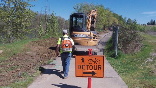 A helpful sign points to a way around the work site Wednesday afternoon.