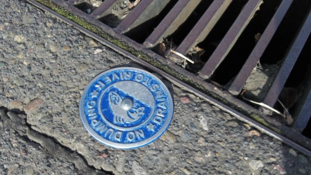 Would parking lot warning against dumping satisfy the EPA?