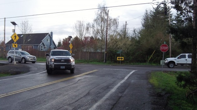 A driver turns right from Gibson Hill on Crocker Lane.
