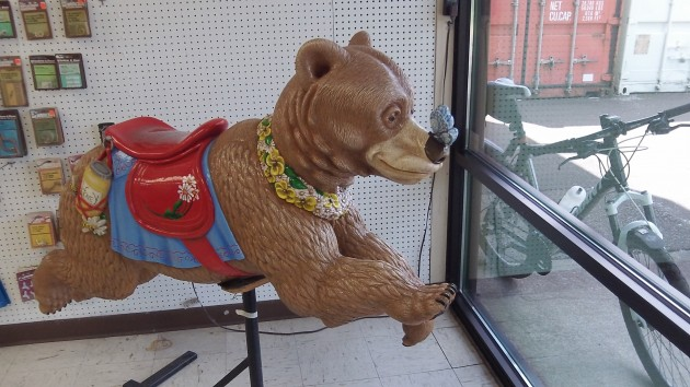 Complete with butterfly on its nose, the bear gallops toward the glass at Smith Glass.