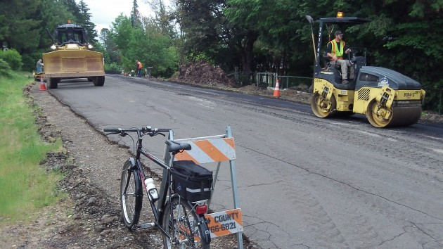 Benton County road crew at work this morning on Robinhood Lane in North Albany.
