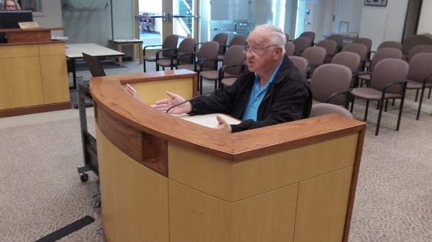 Ray Hilts asks the city council Wednesday to consider a local gas tax to fix streets.