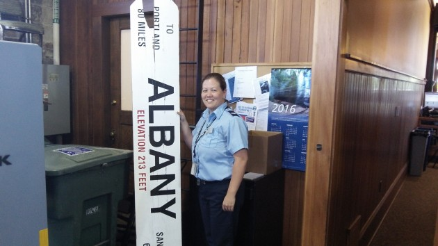 Amtrak's Lori Komp shows me the missing sign in the store room at Albany Station.