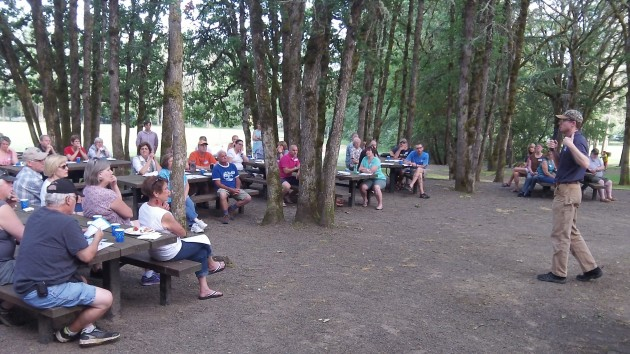 Adam Stebbins talks with residents at North Albany County Park Tuesday evening.