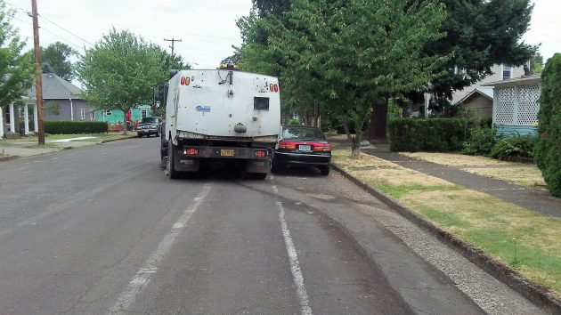 The Albany street sweeper steers around yet another obstacle on Thursday.