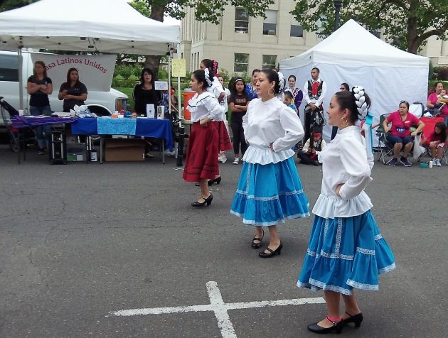 Dancers perform at the farmers' market on Fourth Avenue on July 16.