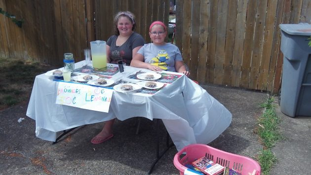 These two were selling lemonade and brownies on Ninth Avenue Friday.