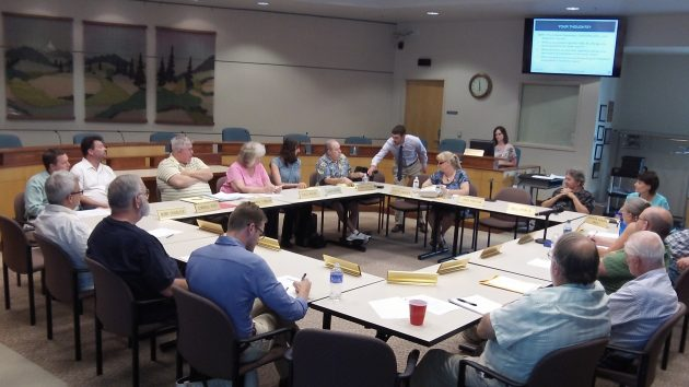 At the table: Planning commission, city council and landmarks commission members.