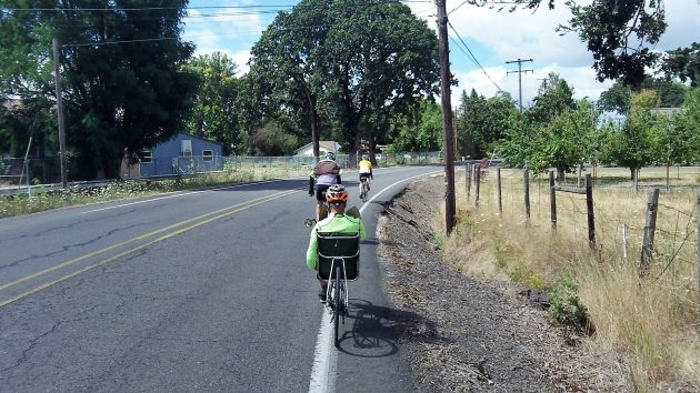 Cyclists cruise along Riverside Drive near the old Riverside School.