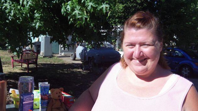 "Christine Rayburn near the ""blessing box"" she started on Salem Avenue."