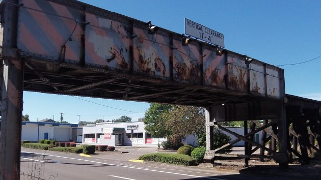 Albany's First Avenue trestle bears the marks of standing up to countless vehicles taller than 11-4.