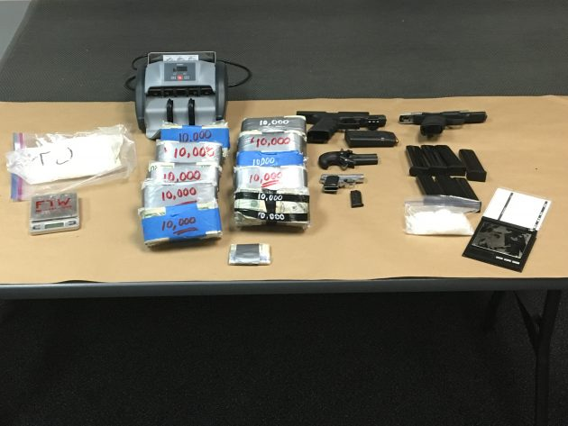 Four handguns were among the items Albany police seized at an Salem address.