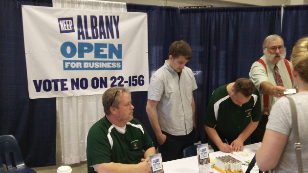 A booth at the Albany business exposition in September. Councilor Ray Kopczynski is the one with big whiskers.