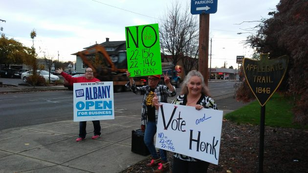 Campaigners against the Albany and Linn County bans on recreational pot commerce whoop it up at Ellsworth and Fourth Wednesday afternoon.