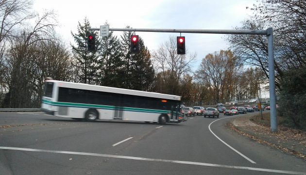 An Albany Transit System bus turns from Spring Hill toward the bridge into town.