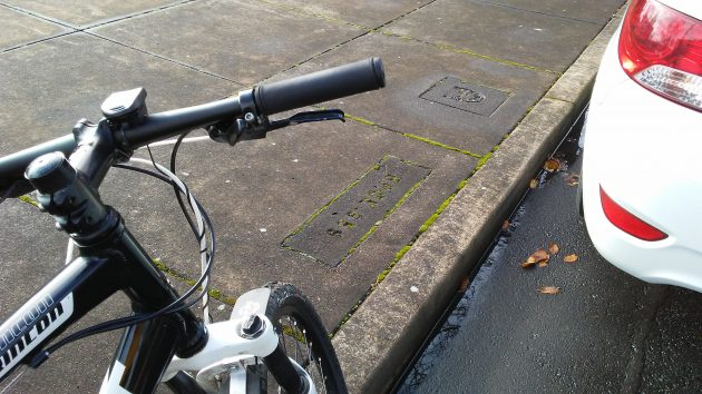 Monday I took another look at the sidewalk inscriptions in front of what used to be 116 West First Avenue.