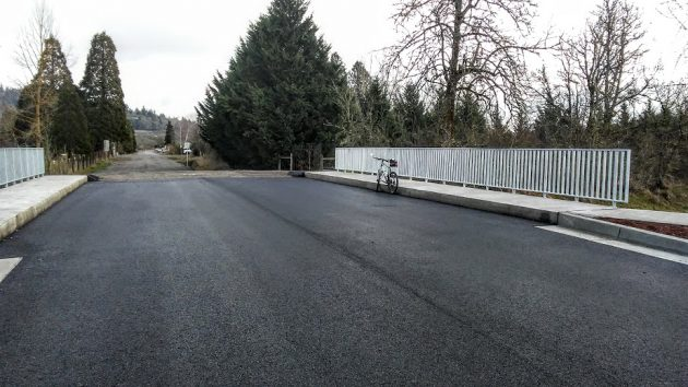 New bridge leads east to a gravel road, then to the Draperville neighborhood,
